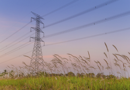 high voltage post or High-voltage tower in a field